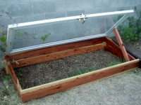 DIY Cold Frame made from a reused storm door and redwood 
