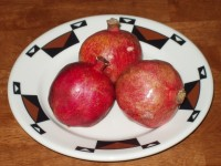 Pomegranates Perched on a Plate