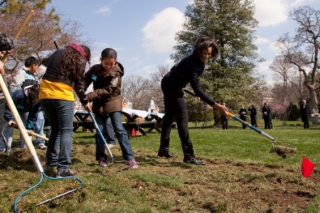 First Lady, Michelle Obama breaking ground for the White House organic garden